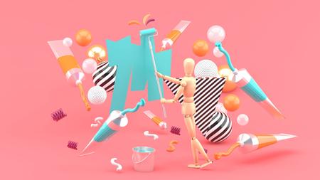 Foto de Wooden puppet Painting amidst colored tubes and colorful balls on a pink background.-3d render. - Imagen libre de derechos