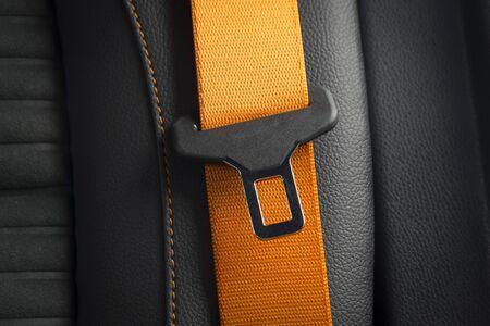 Photo pour Modern race car  black leather interior. Part of orange  leather car seat details. Safety belt close-up - image libre de droit