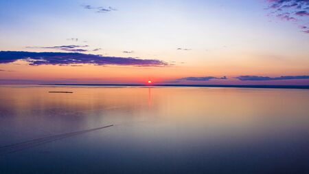 Photo for Sunset sky background. Dramatic gold sunset with evening sky clouds over the lake. Stunning sky clouds in the sunrise. Sky landscape. Panoramic view. - Royalty Free Image