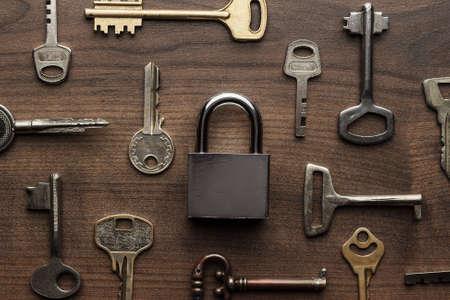 Photo pour check-lock and different keys on wooden background concept - image libre de droit