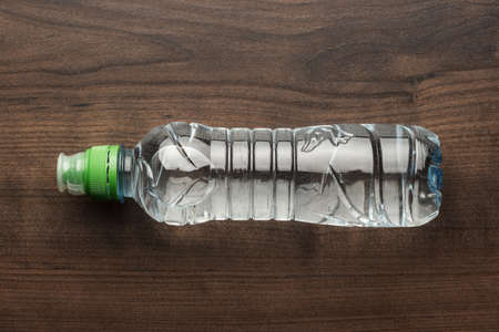 plastic water bottle on the wooden table