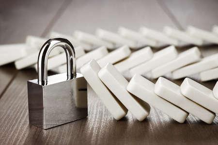 Photo pour padlock standing still reliability concept on wooden table - image libre de droit