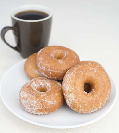 Donuts with coffee on a Linen background.