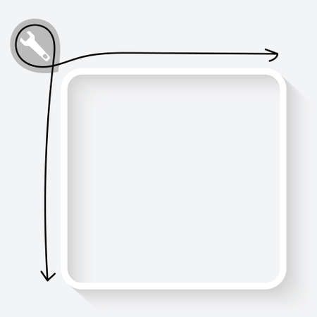 A white text box and spanner icon