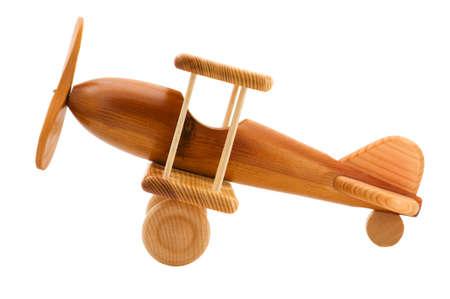 Foto de object on white - wooden toy airplane  - Imagen libre de derechos