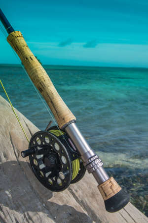 Photo pour Saltwater fly fishing fly rod and reel an the beach in Caribbean sea - los roques - image libre de droit