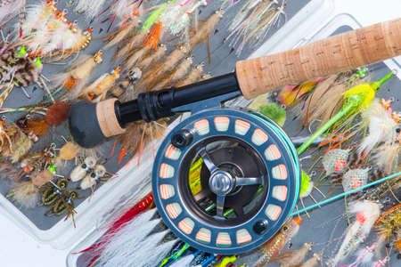 Photo pour Saltwater fly fishing flies and fly rod and reel - image libre de droit
