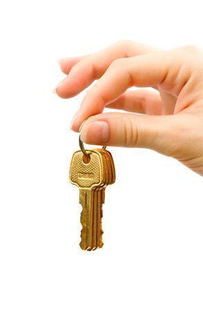 Hand with keys isolated on white