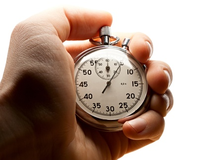 Male hand holding stopwatch