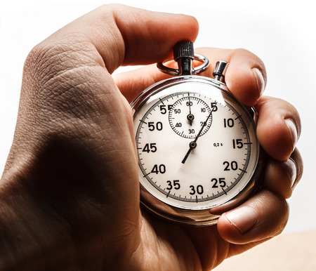 Male hand holding stopwatch on white background