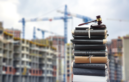 Photo pour Document files with gavel on buildings under construction - image libre de droit
