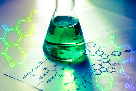 Photo for Chemical tube with reaction formula in light - Royalty Free Image