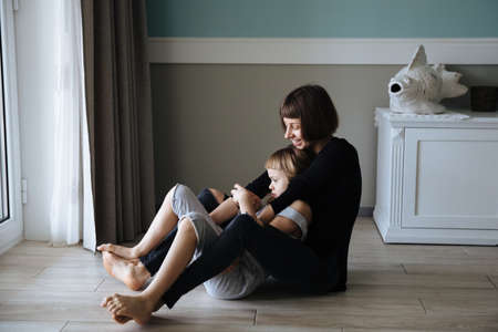Photo pour Close Up Of Affectionate Mother And Daughter At Home - image libre de droit