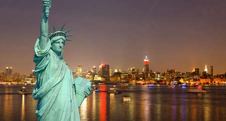 The Statue of Liberty and New York City skylines at night