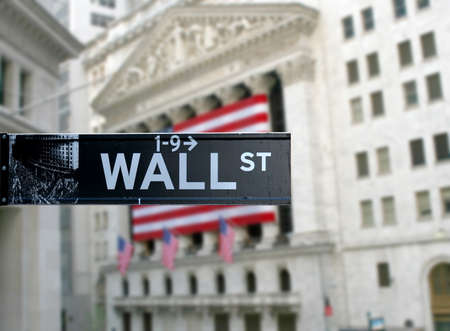 Wall street sign with New York Stock Exchange background