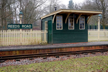 Old retro vintage style railway or railroad stop on a narrow gauge train track