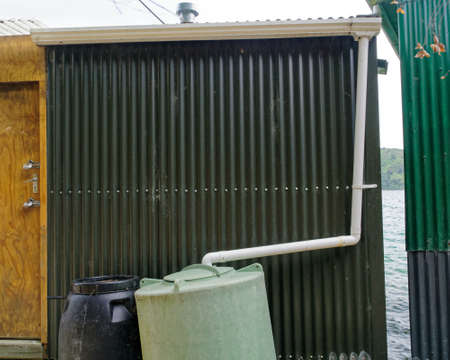Foto für Living off the grid. Roof rain water collection on a boat shed in the Marlborough Sounds, New Zealand. - Lizenzfreies Bild