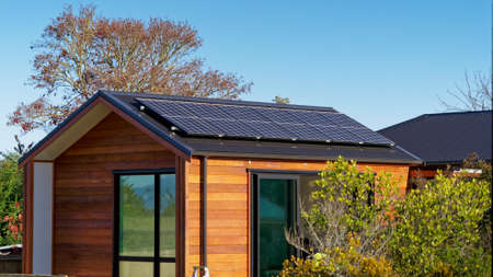 Photo for Living off the grid. Solar panels providing electricity to an off grid house in New Zealand's back country. - Royalty Free Image