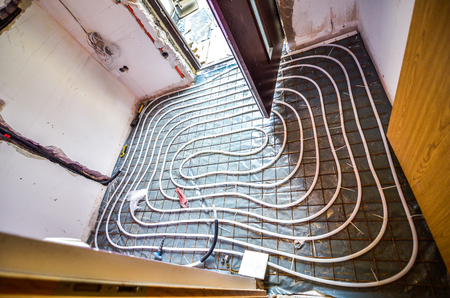 Floor Heating instalation in house renovation, adaptation. Rebuilding old house