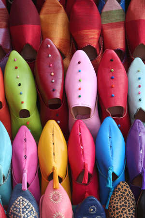 Colorful aligned shoes in arabic shop