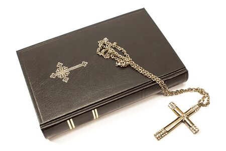 Foto de Holy bible with silver cross isolated on white background - Imagen libre de derechos