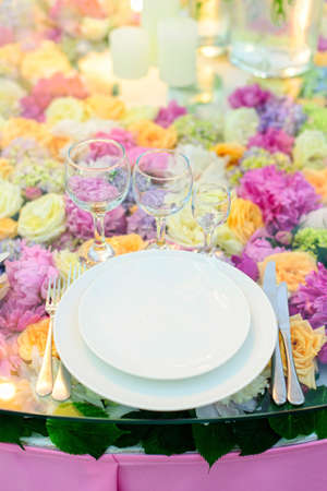 Beautifully served table in a restaurant  Luxury table service on the flower background in an event, celebration or wedding