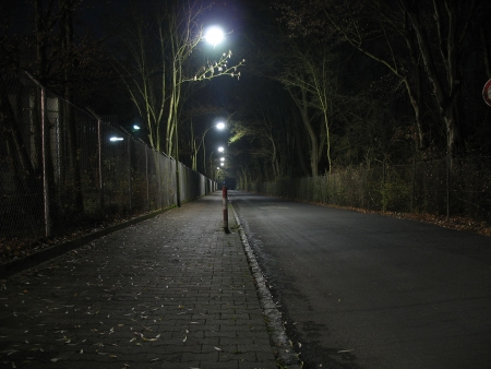 series of streetlights illuminating a deserted road