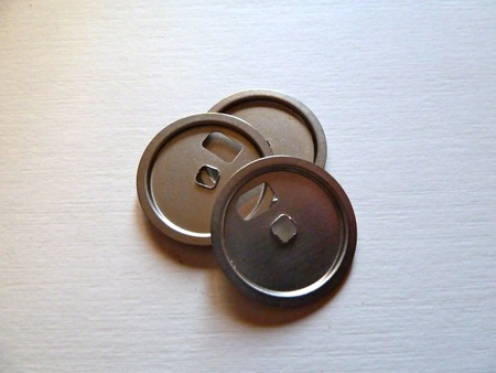 closeup of shiny silver discs on white