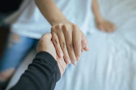 Photo pour True friendship concept,Asian couples lover holding hands to encourage in times of disappointment or life problems together,Close up - image libre de droit