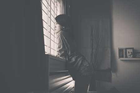 Photo pour Female looking something on window with feeling unhappy and confused problem in personal life,Unexpected pregnancy concept,Black and white toned - image libre de droit