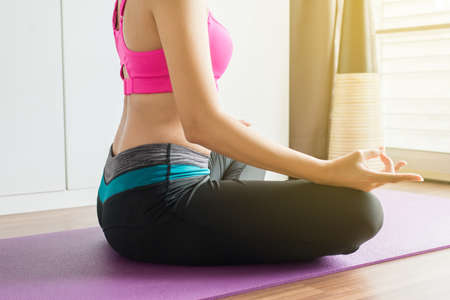 Foto für Women sitting on bed practicing doing yoga meditation, workout after waking up at home, Healthy and  lifestyle concept, Close up - Lizenzfreies Bild