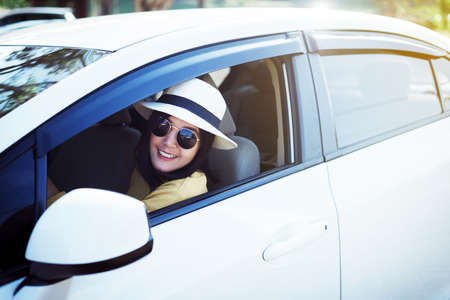 Photo pour Hipster asian woman wearing hat and sunglasses sitting in her car at outdoor, Relaxing time, Positive thinking - image libre de droit