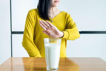 Photo pour Woman hands refusing a glass of milk,Female having allergy milk,Lactose intolerance concept - image libre de droit