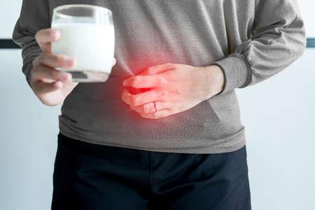 Photo pour Allergy dairy intolerant,Lactose intolerance concept,Asian woman having a stomach pain with a glass of milk - image libre de droit