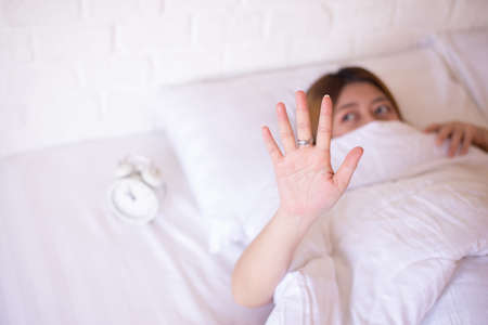 Photo pour Nightmare or bad dream,Asian woman with fear and panic while lying down under the blanket in bedroom - image libre de droit