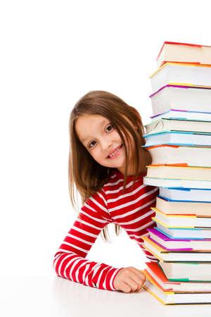 Girl peeking behind pile of books on white background