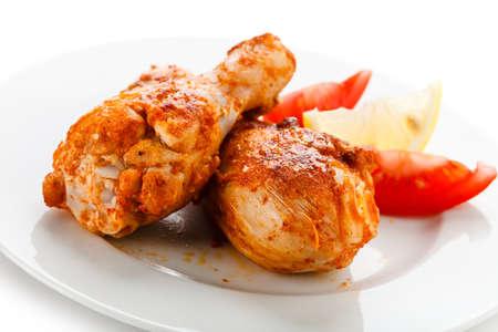 Roasted chicken drumsticks and vegetables