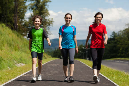 Active family - mother and kids wlking , running outdoor