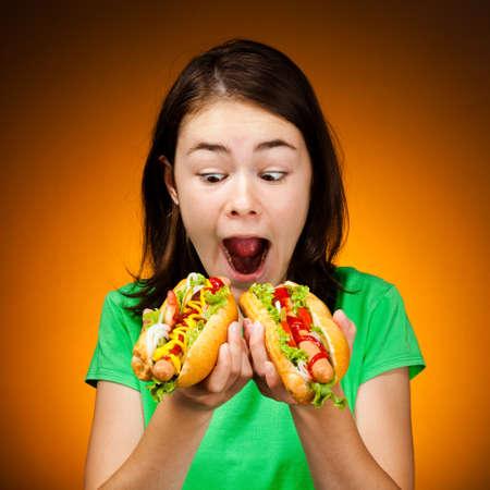 Girl eating big sandwiches