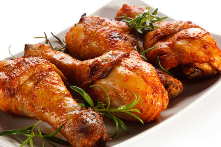 Grilled chicken legs on white background