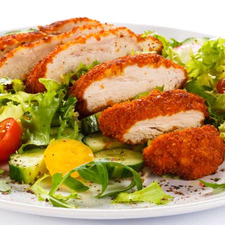Fried chicken fillet and vegetables