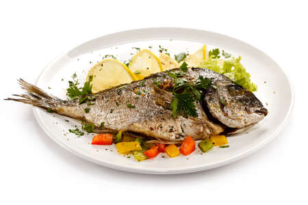 Foto de Fish dish - roasted fish and vegetables - Imagen libre de derechos