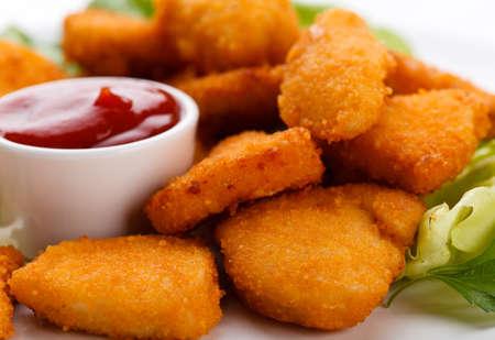 Chicken nuggets on white background