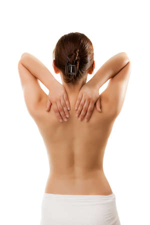 Woman massaging pain at the back of her neck