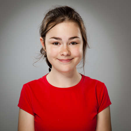 Portrait of girl smiling on isolated gray gradient background