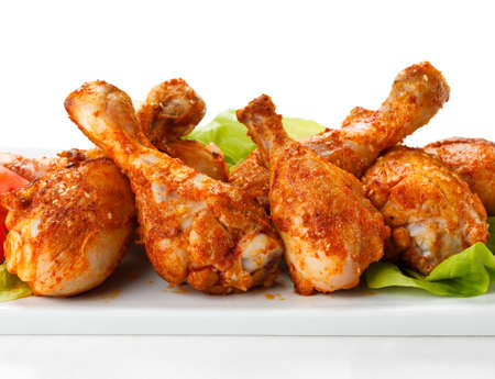 Close up of roasted chicken drumsticks