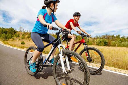 Photo for Healthy lifestyle - teenage girl and boy cycling - Royalty Free Image