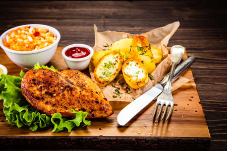 Photo for Grilled chicken fillet with baked potatoes and vegetables - Royalty Free Image