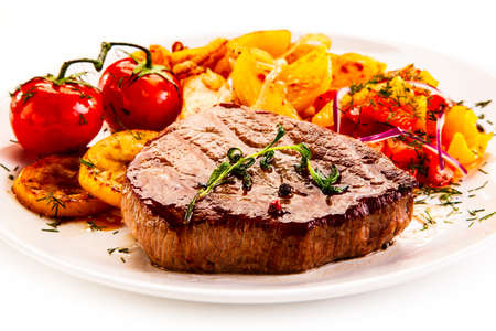 Photo for Grilled steak with fried potatoes and vegetables on white background - Royalty Free Image