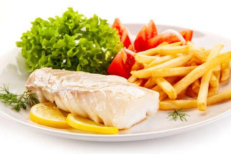 Photo pour Fish dish - fried cod fillet with vegetables on white background - image libre de droit